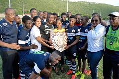 Members of the Jamaica College team pose with the Olivier Shield after defeating STETHS 2-1 at the Stadium East Field on Saturday.